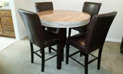I purchased this 5-piece dining room set from Marlo Furniture 2 years ago. Marble table, 4 high-back chairs. I love this set and would keep it if I had the space. Its a great dining set!
