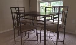 This dining set (color: Espresso) from Walmart is just 8 months old. It has a wooden table-top and four upholstered chairs, with metal frame. Have to sell as am relocating. It's in pretty good conditi