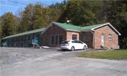34 Unit Motel with Laundry and Manager Apartment that is located on I-40 at Exit 152 (Bucksnort Exit). Motel has Wi-Fi, Direct TV, & City Water, Selling below State Appraisal of $510,000.  Details Pro