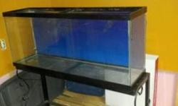 i have a 55 gallon aquarium.includes black wrought iron stand.a beveled glass shelf for the bottom.or you can fit another tank on the bottom.2glass lids.aqua clear 110 filter.a hydro heater.air pump.n