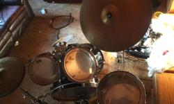 Sitting in my attic I have this 5pc black drum set. It used to play gigs but those days are over. If your thinking about trying out a new fun hobby that will turn into talent, buying this set wil