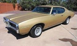 Condition: Used. Outside color: Gold. Interior color: Tan. Transmission: Automatic. Engine: 8. Drivetrain: RWD. Car title: Clear. Body type: Coupe. Warranty: Vehicle does NOT have an existing guarante