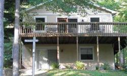 CUTE WELL MAINTAINED 2 BR COTTAGE ON A QUIET COVE NEAR MAIN BODY OF SWEETWATER LAKE.MANY RECENT UPDATES INCLUDINGNEW DOCK, FIRERING & BENCHES, KAYAK RACK, NEW STEPS DOWN SIDE OF COTTAGE, AND LOTS OF LANDSCAPING. INTERIOR NEW BAMBOO FLOORING IN KITCHEN