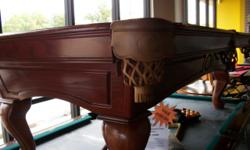 """I have an Oak C.L. Bailey pool table for sale. The finish is a custom Modern Mahogany on Oak and the table has 3 piece full 1"""" framed slate. The sub-frame is made from LVL which is floor joist beams f"""