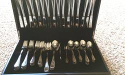 Brand New, Never Used 94 Piece Flatware Set in beautiful wood box.  This stainless steel flatware set includes:  16 Dinner Knives 16 Dinner Forks 16 Salad Forks 16 Soup Spoons 16 Tea Spoons 4 Serving