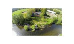 Westwind Farms - a 45 acre equestrian farm on the Applegate River with 2000 ft. of pristine river frontage with exceptional steelhead and trout fishing. Situated just 10 miles from historic Jacksonvil