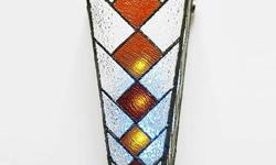 Cone-shaped Stained Glass Sconce from Overstock.com, never used. see link below:  http://www.overstock.com/Home-Garden/Cone-shaped-Stained-Glass-Sconce/4329083/product.html  Two of them ,sale for half