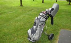ADAMS golf club set fresh, Only used a few times. Paid 950.00 asking 500.00. Cart and bag included. SALE: 450.00