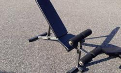 Active Fitness Adjustable Incline/Decline FID Bench. This is an extremely tough bench. The back adjusts from decline all the method to 90 degrees. Includes 3 accessories! Preacher curl pad, leg extens