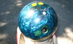 BOWLING BALL,Amflite. Ball is teal colored weighs 13lbs. Well used with some gouges in surface from picking up all those spares, but ball is still very usable. Ball can be seen and picked up in Winter