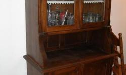 Antique china cabinet  pretty sure its well over 200 years. Purchased it in Holland over 30 years ago  and it looks about the same now as then. The wood is feather light, even though Ive kept it well