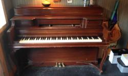 Antique Janssen console piano with unique design. All three of our children discovered piano on this. Has a youngster's trademark (shown in one picture) which was there when we purchased it at Strait