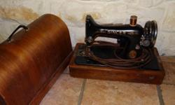 Antique black sewing machine with gold trim and a wooden case. made in Simanco, USA made in 1939? I think. AB917403 model#