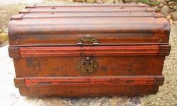 Great old rustic look to a well used all metal, flat top steamer trunk. It's still a strong and sturdy with a good, solid bottom and the hinged top works perfectly. Clean and ready to use with new fel