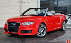 2008 Audi RS 4 Convertible in Misano Red Pearl Effect with Silver 'Silk Nappa' Leather Interior and Black Soft Top. Only 25,898 two-owner miles. 4.2L/420HP V8 Engine. 6-Speed Manual Trans. Quattro All