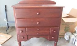 This is a lovely strong cherry child furniture set by Ragazzi! It includes a baby crib (no bed mattress), 3 drawer dresser / changing table and a closet armoire with a drawer and shelves. Both dresser