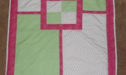 Measures 39 by 31 inches. Mint Green and Pink, white back. Machine quilted. Made in a smoke free home