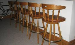 6 Solid Oak Swivel with  Seat Back   Bars Stools   For Sale  They are all in excellent condition!  Purchased at Banworth and Udelhoven at over $150.00 ea.  Very confortable and fitting.    Height 42""