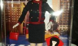 Barbie doll as That Girl pays tribute to this preferred character from television history. Her beautifully comprehensive ensemble is motivated by the show's opening film montage. She uses a navy blue