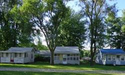 BASS LAKE WATERFRONT- INVESTMENT PROPERTY - 3 COTTAGES FOR ONE PRICE 5423 E Riviera Ct BASS LAKE WATERFRONT- INVESTMENT PROPERTY - 3 COTTAGES FOR ONE PRICE- Steps away from beautiful bass lake, private pier accessed by a 10 ft deeded easement; amazing