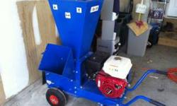 FOR SALE OR TRADE. Approximately 3 year old wood chipper/ shredder with less than 15 hours of use. It has a Honda 8 HP engine and everything is in mint condition. This is a solid, well built, high end