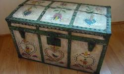 Made in the late 1800's, this kid size wooden hump back trunk/chest is still in good, functional condition to store things in and the folk created, Pennsylvania Dutch art work on the front and top are