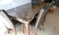 Faux granite top table and 4 leather chairs, like new $350.00 or finest offer. Glass and wood coffee and end tables, few small scratches, gold trim - $95.00 or best offer. Dark wood rattan chair (plus