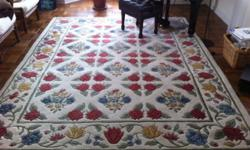 8' x 10.6' area rug -- hand loomed -- 100% wool -- made in India -- comes from a smoke-free, pet-free environment -- vibrant colors -- no stains / bare spots, etc. EXCELLENT condition.