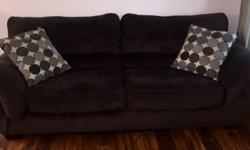 Beautiful chocolate brown, microfiber living room set for sale. The large 7' couch and oversized chair have been protected with Scotchgard and are extremely comfortable. The set includes two matching