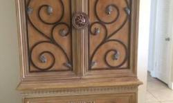 Two piece Queen bedroom set made up of a Victorian styled headboard that marries interesting scroll work detail and sculpted finials that harmoniously match the wardrobe armoire.Both the bed and the w