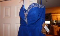 Sale: Absolutely Beautiful NEW, never used Prom Gown in magnificent Royal Blue. This dress has a Beautiful shimmering Cystals and Silver Sequin trimmed sweetie neck line tapering down into a V on the