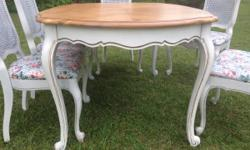 I'm selling a spectacular, solid wood shoddy elegant style dining table with 6 cane back chairs. The set has been refinished in an off white with stressful and a blue gray glaze. This set is in excell