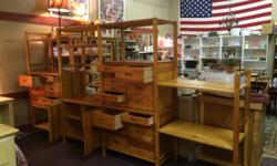 This bedroom wall unit has several shelves that you can position at any height and then slide any of the 3 units with drawers or 1 unit with doors and cubbies  on any of the shelves. There will be ext
