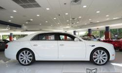 This 2014 Bentley Continental Flying Spur 4dr Mulliner Sedan features a 6.0L 12 CYLINDER 12cyl Gasoline engine. It is equipped with a 8 Speed Automatic transmission. The vehicle is Glacier White with