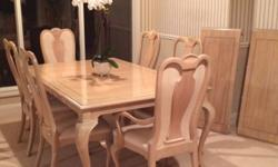 Bernhardt Dining Set. Excellent condition. Table with two leaves, 6 chairs. Table seats up to 10.China Hutch, with glass shelves, recessed lighting. Call 707-259-XXXX