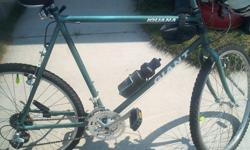 """This is a 28"""" Mountain Bike, It is hammer green and has been refurbished like new. Iguana Giant is the bike"""