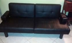 """Nice black leather futon.96"""" wide, fold down ajustable backrest, armrest with cupholders..good condition...small sctrathes on left front corner...$60...Hialeah, Fl. Oscar203-751-XXXX"""