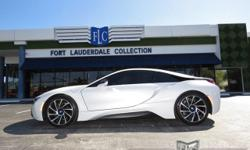 This 2014 BMW i8 2dr features a 1.5L 3 CYLINDER 3cyl Hybrid engine. It is equipped with a 6 Speed Automatic transmission. The vehicle is Crystal White Pearl Metallic with Frozen Gray Accent with a Ter