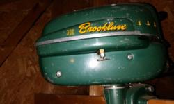 Brooklure 300 small boat or canoe motor. Has good compression, never been restored. This is a collectors item.