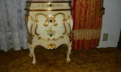 """Made in Italy, 100 % Wood Ivory Bombe' chest with hand painting and authentic hand used gold metal leaf trim, measures 26""""Hx11Dx21W w/one small and 2 big drawers, is in nearly new condition. This piec"""