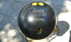 BOWLING BALL, COLUMBIA U300. Ball is black and weighs 13.5 lbs. Drilled for finger tip bowler, but of course, can be plugged and re drilled at your bowling Pro Shop to make this your personal bowling