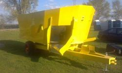 """Brand new LEO 70625 Dual Auger low profile (88"""" Tall) vertical feed mixer. This mixer is ready to mix for feeding on floor. This includes scale system, hay catch chain, LED lights, extra knives, Heavy"""