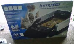 Littermaid automatic kitty litter box brand new in box, never opened. Includes the litter box, cover, extra waste bins, and scooper. I spent around 300 on everything when i first got it. Any questions