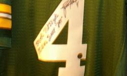 "I have a Brett Favre autographed jersey,With his inscription of his stats on it, 508tds-71,838yds-185wins-3xMVP ""297: along with cert.of authentifcation and a picture of him signing the jersey. Seriou"