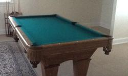 A like new Brunswick Pool Table (Contender) with two Darafeev Pool Table Chairs