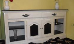 This has actually been hand repainted and distressed and can be made use of as a serving dresser, buffet or tv stand. It is wood and strong. Beautiful black and white, looks really stylish. Terrific c