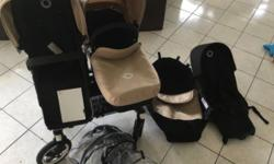 Bugaboo Donkey Duo in sand and black 2 Seats 2 bassinets 2 rain covers 2 Think King hooks (for holding bags etc) User guide 1 Storage basket for when it converted to single Pram In Excellent condition