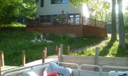 Beautiful Spacious Cabin located directly on the water of Wixom lake. The cabin is loaded with bear,fish,moose,duck,deer,turkey and fishing decor. The cabin is located in a very secluded area of seaso