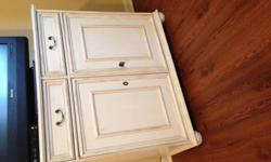 Cabinet for sale, in great condition. Solid wood with distressed antique white finish. Has 2 drawers and 2 doors that open to a wide space with a shelf for storage.size: 38x16