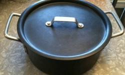 This is a used Calphalon commercial grade hard-anodized aluminum 5 quart # 8785 dutch oven with the # 311C lid. It is perfect for innovative food preparation methods such as deglazing and searing and